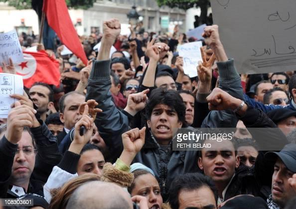 Tunisian demostrators shout slogans in front of the interior ministry in Habib Bourguiba avenue in Tunis after Tunisian President Zine El Abidine Ben...