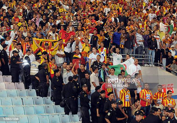 Tunisian Esperance de Tunis and Algerian fans react during their African Champions League football match semifinal against Egyptian AlAhly on October...