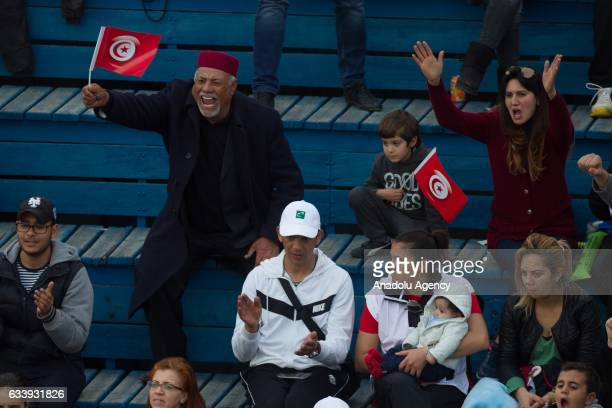 Tunisian fans support Mohamed Aziz Dougazi of Tunisia during his second round single tennis match against Isak Arvidsson of Sweden in the Davis Cup's...