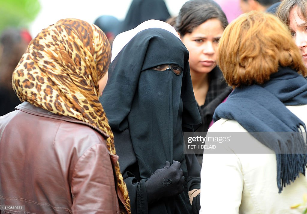 Tunisian first year student of Arabic, Imen Berrouha, wearing a niqab, talks with other students on March 7, 2012 in Tunis. Imen Berrouha accused the Dean of 'hitting 'her during an altercation last night and says she has a medical certificate.
