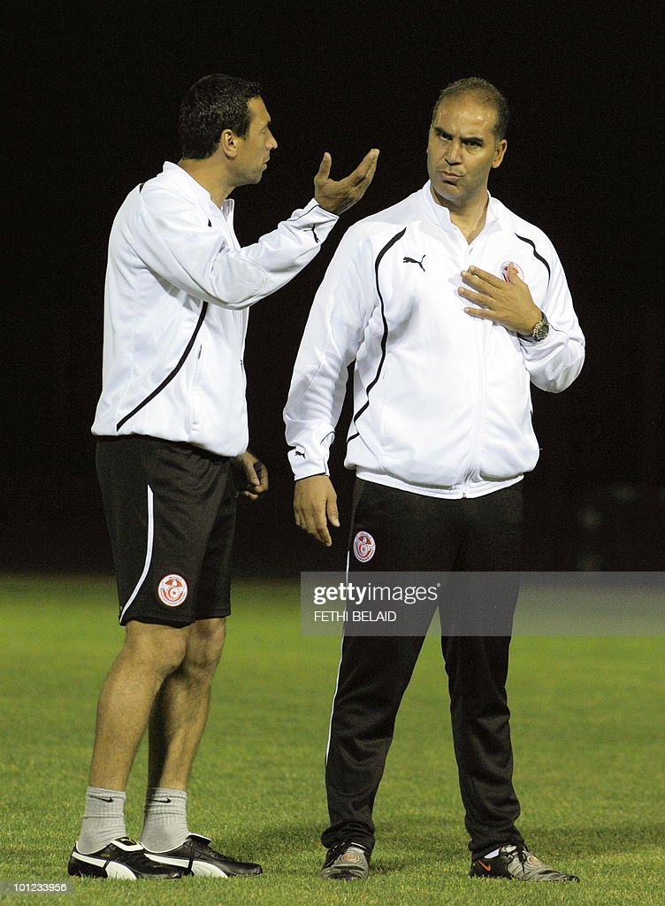 Tunisian football national team's coach Sami Trabelsi(R) with his assistant Ali Boumnijel(L) during a training session, on May 28, 2010 in Rades near Tunis, two a days before their friendly match against France in Tunis.