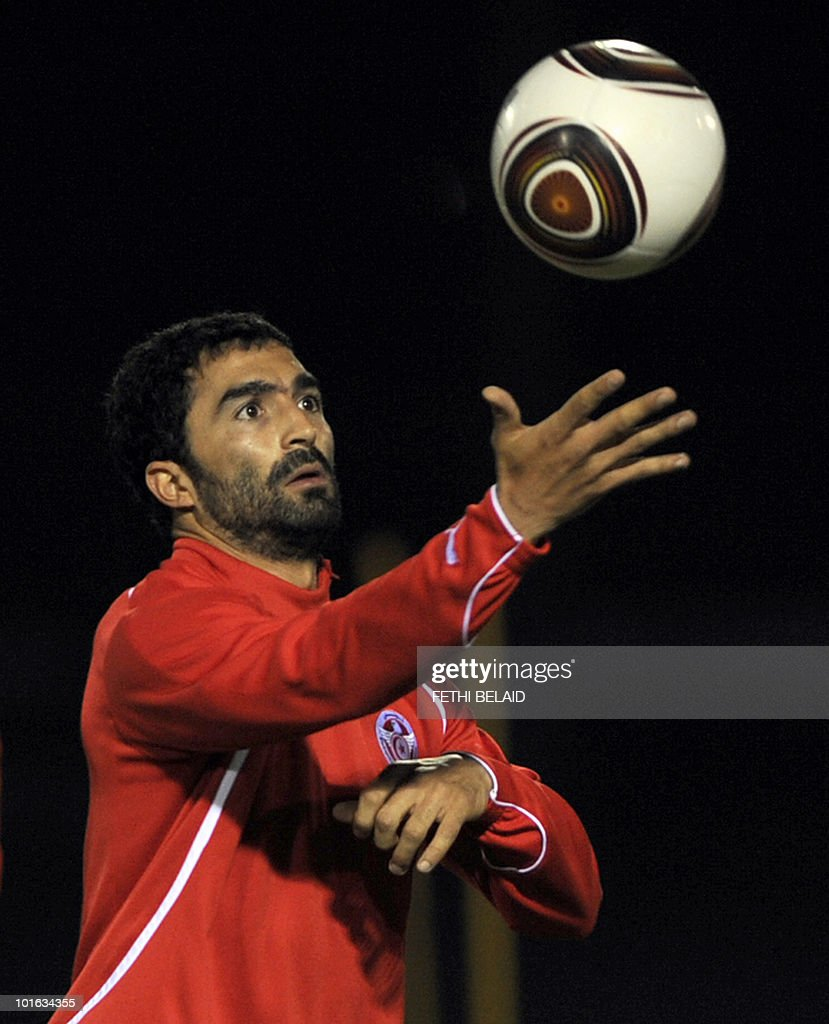 Tunisian football national team's striker Fehid Ben Khalfallah eyes a ball during a training session on May 28, 2010 in Rades near Tunis two a days before their friendly match against the French team in Tunis.