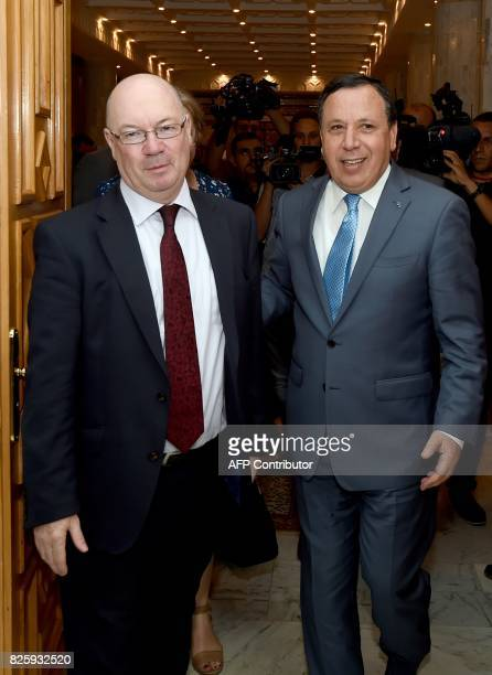 Tunisian Foreign Minister Khamaies Jhinaoui receives British minister of state for the Middle East and North Africa Alistair Burt in the capital...