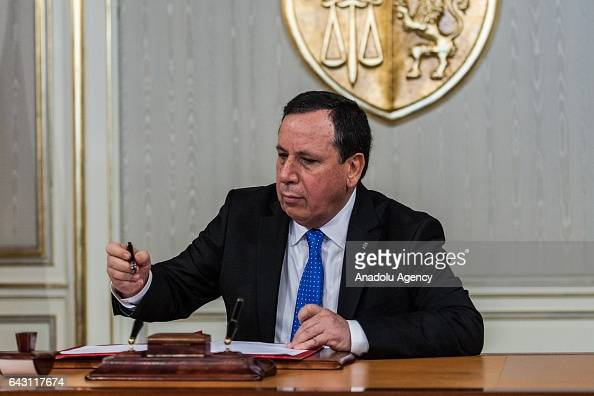 Tunisian Foreign Minister Khemaies Jhinaoui signs a memorandum of understanding as he gathers with Tunisian President Beji Caid Essebsi Egyptian...