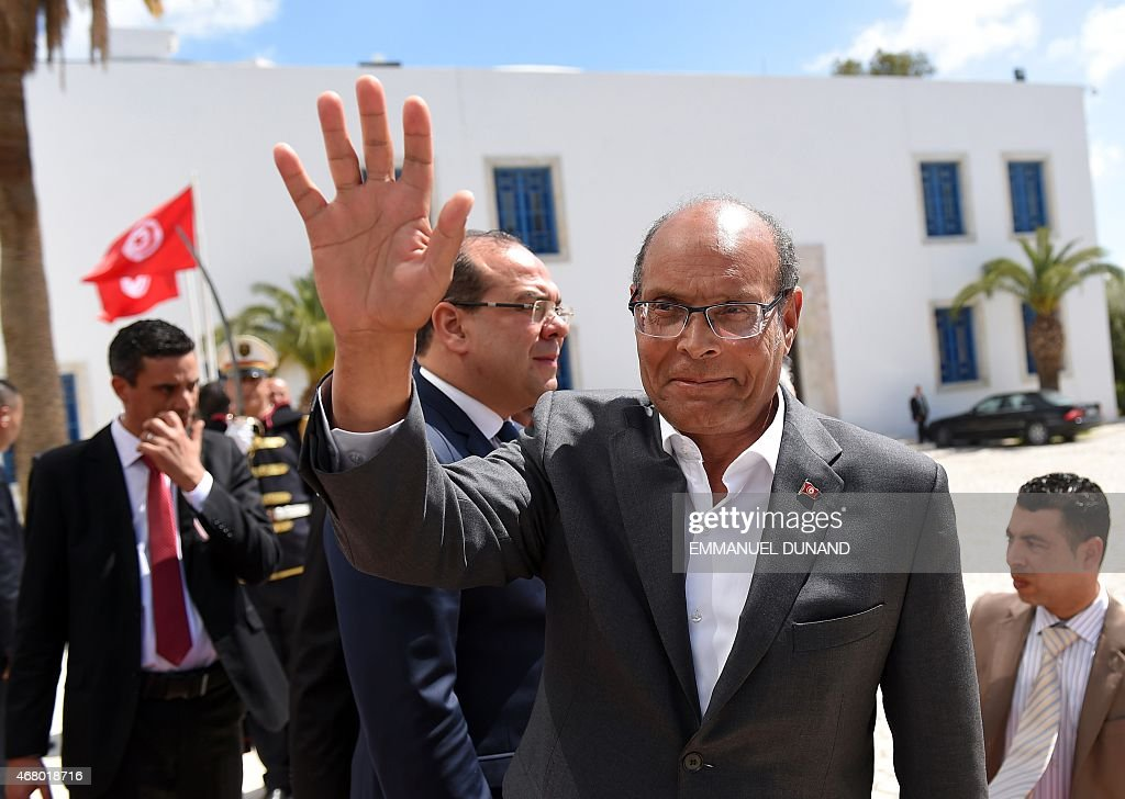 Tunisian former president <a gi-track='captionPersonalityLinkClicked' href=/galleries/search?phrase=Moncef+Marzouki&family=editorial&specificpeople=2893986 ng-click='$event.stopPropagation()'>Moncef Marzouki</a> arrives to take part in an anti-extremism march, in Tunis, on March 29, 2015 following the massacre of foreign tourists at the country's national museum.