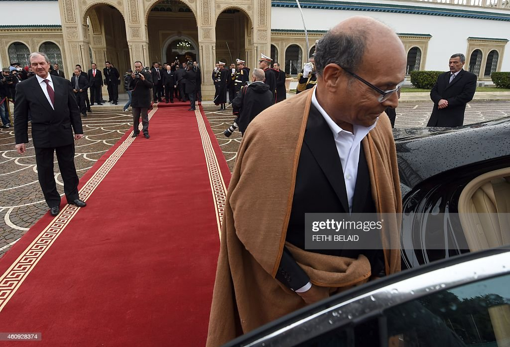 Tunisian former president <a gi-track='captionPersonalityLinkClicked' href=/galleries/search?phrase=Moncef+Marzouki&family=editorial&specificpeople=2893986 ng-click='$event.stopPropagation()'>Moncef Marzouki</a> leaves the Carthage presidential Palace at the end of a handover ceremony on December 31, 2014 in Tunis. The election of Beji Caid Essebsi, a veteran of previous regimes, is seen as a landmark for the North African nation, where longtime dictator Zine El Abidine Ben Ali was toppled in 2011.