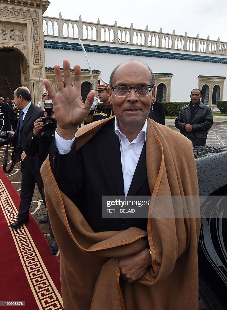 Tunisian former president <a gi-track='captionPersonalityLinkClicked' href=/galleries/search?phrase=Moncef+Marzouki&family=editorial&specificpeople=2893986 ng-click='$event.stopPropagation()'>Moncef Marzouki</a> waves as he leaves the Carthage presidential Palace at the end of a handover ceremony on December 31, 2014 in Tunis. The election of Beji Caid Essebsi, a veteran of previous regimes, is seen as a landmark for the North African nation, where longtime dictator Zine El Abidine Ben Ali was toppled in 2011.