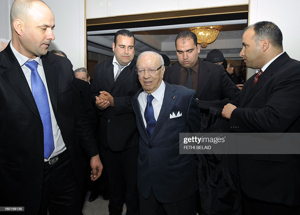 Tunisian former prime minister and opposition leader, Beji Caid Essebsi (C) arrives to give a speech during an open day to mark the first anniversary of his party 'Nidaa Tounes' on January 27, 2013, at the Congress Hall of Tunis. Essebsi, has shown its support with the call of the prime minister Hamadi Jebali for a national dialogue and pointed out in his speech that the current government has failed on all fronts and that the change should be radical without stopping simply a cabinet reshuffle.