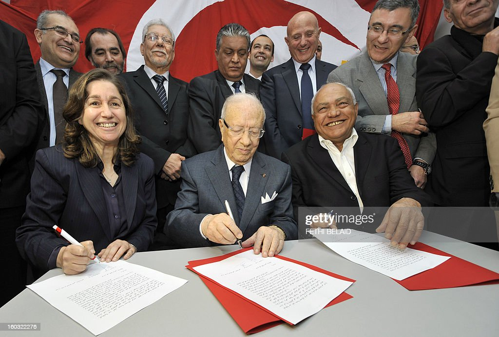 Tunisian former prime minister Beji Caid Essebsi (C) signs with the general secretary of the Republican party 'Aljoumhouri' Maya Jerbi (L) and Ettajdid party General Secretary Ahmed Brahim (R) a tripartite pact of union and announcing the creation of front of the 'Union for Tunisia' on January 29, 2013 in Tunis. Highlighting the failures and shortcomings of the government to the Troika, the signatories forming the front, stated in their agreement 'in order to cope with the difficult situation of the country and insecurity and to create a balance between the political forces, it was decided to create a political front and electoral uniting the three signatory parties and remains open to other parties will join the front.'