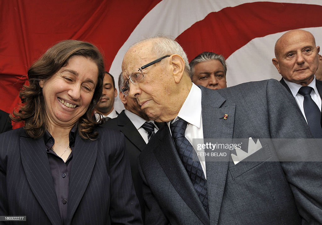 Tunisian former prime minister Beji Caid Essebsi (C) talks to the general secretary of the Republican party 'Aljoumhouri' Maya Jerbi (L) after signing a tripartite pact of union and announcing the creation of front of the 'Union for Tunisia' on January 29, 2013 in Tunis. Highlighting the failures and shortcomings of the government to the Troika, the signatories forming the front, stated in their agreement 'in order to cope with the difficult situation of the country and insecurity and to create a balance between the political forces, it was decided to create a political front and electoral uniting the three signatory parties and remains open to other parties will join the front.'