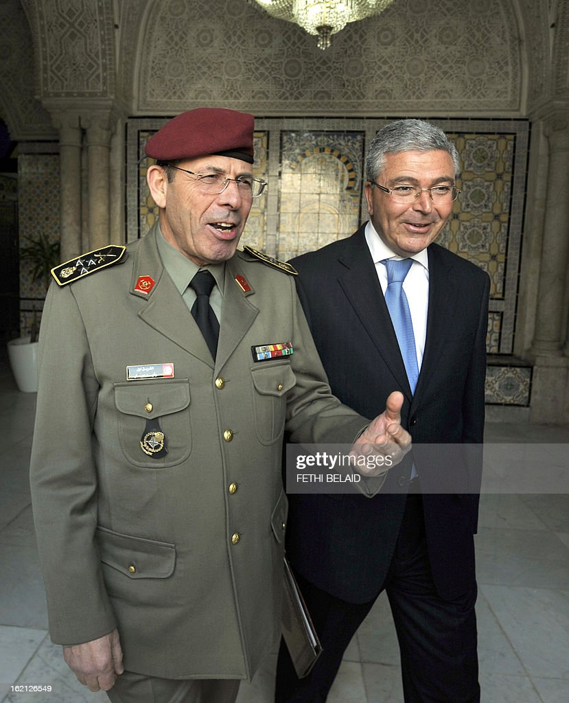 Tunisian General Rachid Ammar (L), the Chief of Staff of the Tunisian Armed Forces, and Tunisian Defence Minister Abdelkarim Zbidi (R) arrive to meet with Tunisian Prime Minister Hamadi Jebali on February 19, 2013, in the la Kasbah area of Tunis. Jebali is pursuing 'another solution' to Tunisia's biggest political crisis since the uprising two years ago after his plan to form a cabinet of technocrats failed.