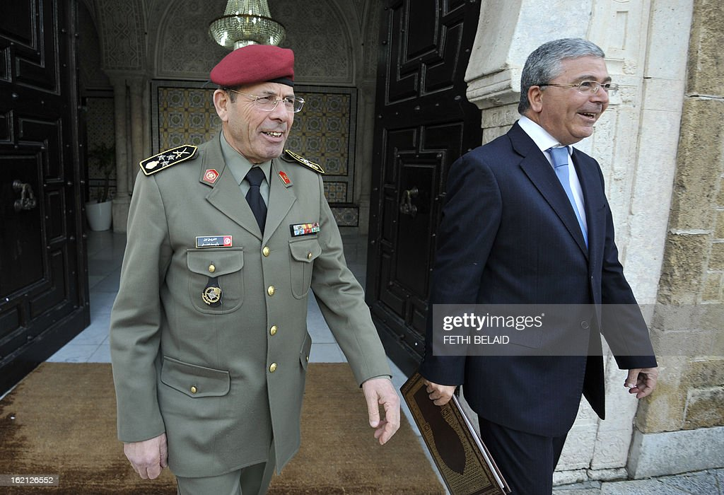 Tunisian General Rachid Ammar (L), the Chief of Staff of the Tunisian Armed Forces, and Tunisian Defence Minister Abdelkarim Zbidi (R) arrive to meet with Tunisian Prime Minister Hamadi Jebali on February 19, 2013, in the la Kasbah area of Tunis. Jebali is pursuing 'another solution' to Tunisia's biggest political crisis since the uprising two years ago after his plan to form a cabinet of technocrats failed. AFP PHOTO / FETHI BELAID