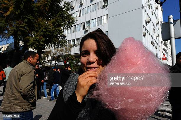 A Tunisian girl eats a cotton candy on February 14 2011 in Tunis on Valentine's Day as the country celebrate a month of freedom With St Valentine's...