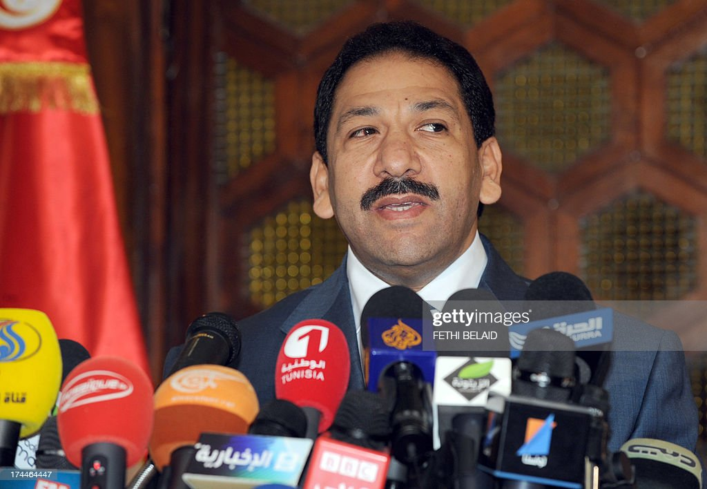 Tunisian Interior Minister Lotfi Ben Jeddou speaks during a press conference in Tunis on July 26, 2013, as the country marks a day of mourning after gunmen killed opposition figure Mohamed Brahmi, sparking fresh political turmoil, protests and a general strike which took Tunis to near standstill. AFP PHOTO / FETHI BELAID
