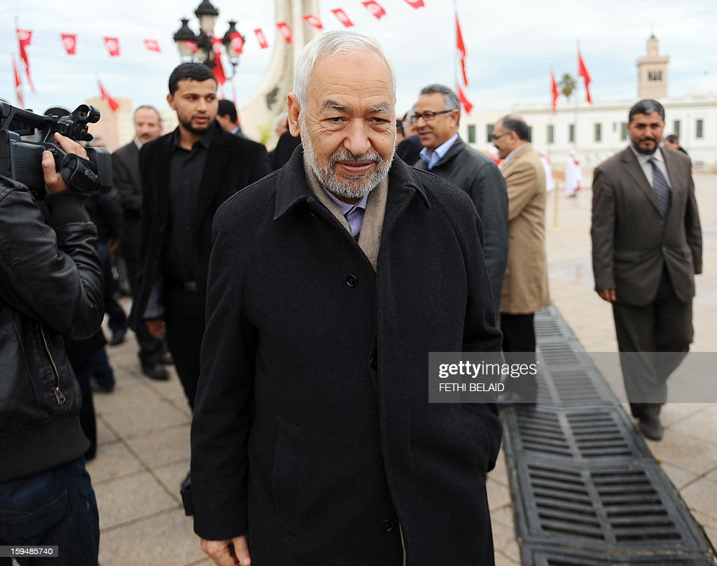 Tunisian Islamist Ennahdha party's leader Rached Ghannouchi (front) arrives to take part in a gathering as part of the festivities marking the second anniversary of the uprising that ousted long-time dictator Zine El Abidine Ben Ali on January 14, 2013 in Tunis. Tunisians marked two years since the revolution amid a climate of uncertainty marked by social tension, a weak economy, threats from jihadists and a political impasse.