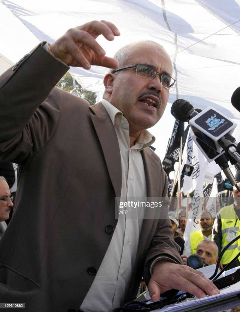 Tunisian Islamist party Hizb Ettahrir's spokesman Ridha Belhaj gives a speech during a demonstration outside the National Constituent Assembly to demand the application of the Islamic sharia law on...