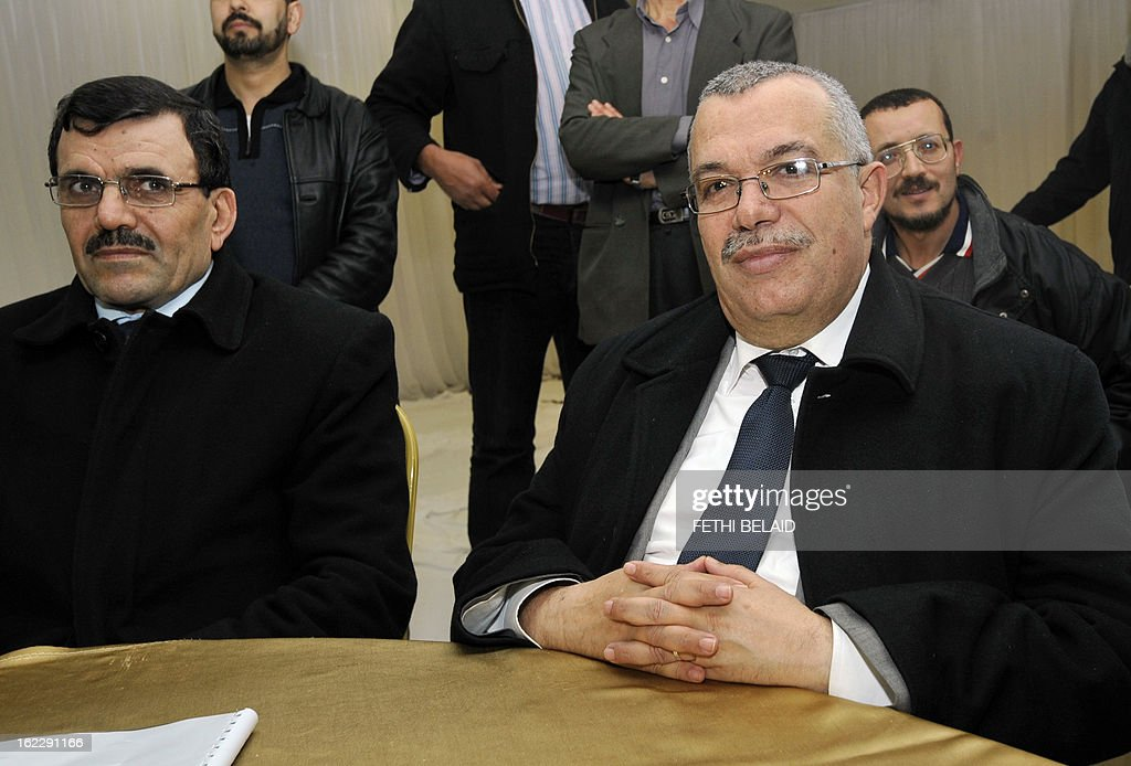 Tunisian justice minister and candidate for the post of prime minister Noureddine Bhiri (R, seated) attends a meeting of the consultative council of Ennahda with Tunisian Interior minister Ali Larayedh (L, seated) to appoint a new prime minister on February 21, 2013 in Tunis. Tunisia was scrambling to find a replacement prime minister and pull itself out of a major political crisis two days after Jebali quit after failing to form a cabinet of technocrats. AFP PHOTO / FETHI BELAID