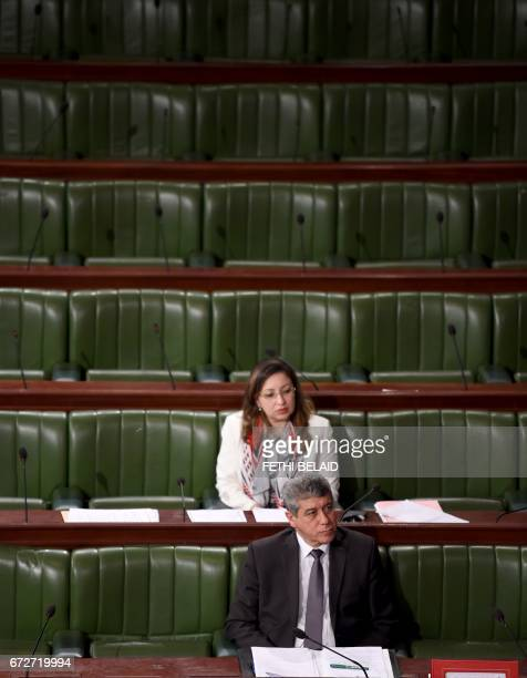 Tunisian Justice Minister Ghazi Jeribi attends a parliament session for the revision by the assembly of the bill amending the country's draconian...