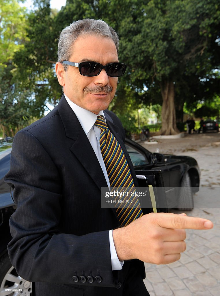 Tunisian Justice Minister Nadhir Ben Ammou arrives to attend a parliament session at the Constituent Assembly on May 8, 2013 in Tunis, on the security situation in Kasserine, the regional capital of the western region of Mount Chaambi, as soldiers continue their hunt for a jihadist group hiding out in the border region with Algeria. Tunisian Prime Minister Ali Larayedh insisted that Tunisia's security situation was improving and that fugitive jihadist groups with links to Al-Qaeda would be defeated.