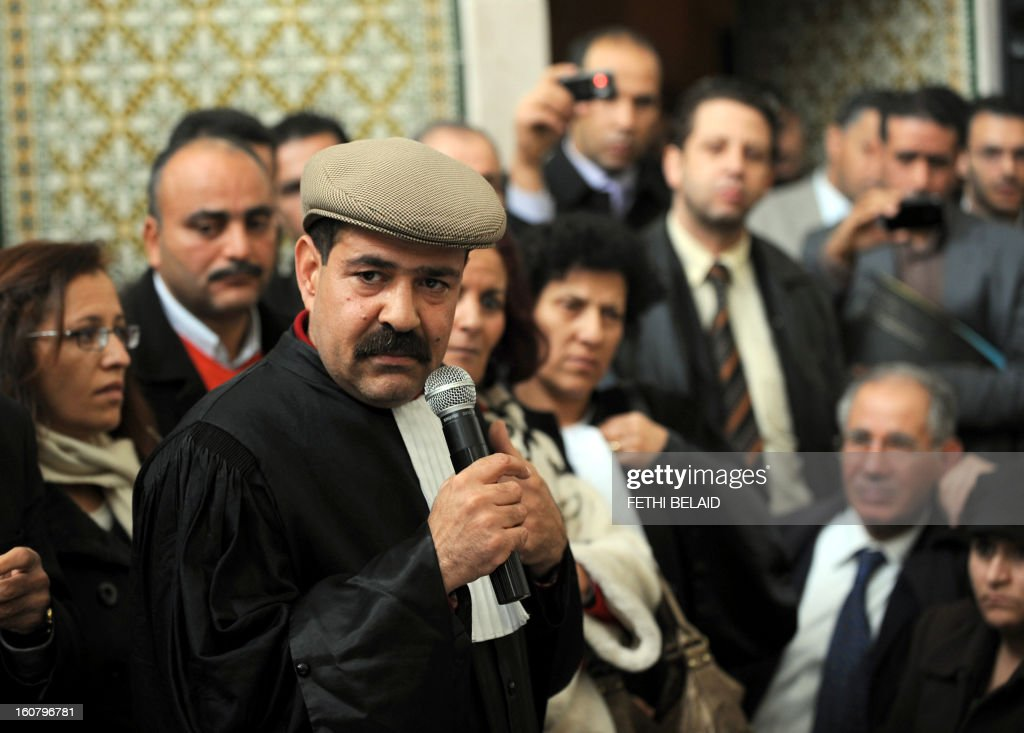 Tunisian lawyer and human rights activist Chokri Belaid speaks as he attends a meeting along with other lawyers in Tunis on December 29, 2010 to express their solidarity with the residents of Sidi Bouzid following days of rioting in Tunisia by mostly jobless and frustrated young people protesting violently against the government has exposed the crippling unemployment problem in the north African country.Unrest has gripped the central Sidi Bouzid region since the attempted suicide on December 17 of a 26-year-old university graduate, who was forced to sell fruit and vegetables on the streets to make ends meet. AFP PHOTO FETHI BELAID