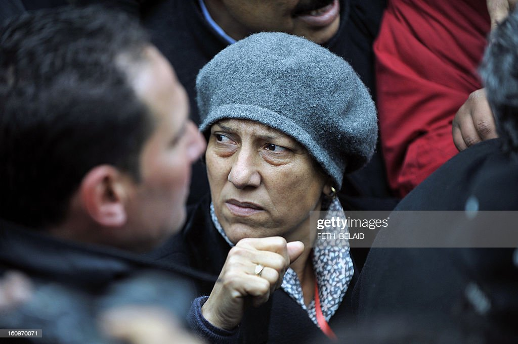 Tunisian lawyer and human rights activist Radhia Nasraoui attends the funeral procession of assassinated opposition leader Chokri Belaid at El-Jellaz cemetery in a suburb of Tunis on February 8, 2013. Tunisian police fired tear gas and clashed with protesters as tens of thousands joined the funeral of Belaid whose murder plunged the country into new post-revolt turmoil.
