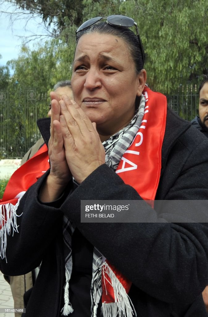 Tunisian lawyer and human rights defender Leila Ben Debba mourns during a demonstration in solidarity with Basma Khalfaoui Belaid following the assassination of her husband Chokri Belaid in front of the National Constituent Assembly on February 11, 2013 in Tunis. Prime Minister Hamadi Jebali's gamble on forming a new government in defiance of his own Islamist party after the assassination of opposition head Chokri Belaid left Tunisia in political limbo. AFP PHOTO/FETHI BELAID