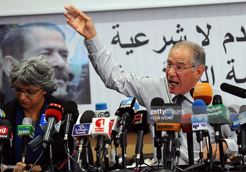 Tunisian lawyer and member of the 'Initiative for the Search for Truth about the Assassination of Chokri Belaid and Mohamed Brahmi' (IRVA), Mokhtar Trifi (R) speaks during a press conference on November 7, 2013 in Tunis to present new documents related to the assassination of the two opposition politicians. IRVA accused the Tunisian Ministry of Interior of 'hidding' ballistic test results conducted in the Netherlands, which would show that Belaid was assassinated on February 6, 2013 with a gun 'belonging to the Interior Ministry'. AFP PHOTO / FETHI BELAID