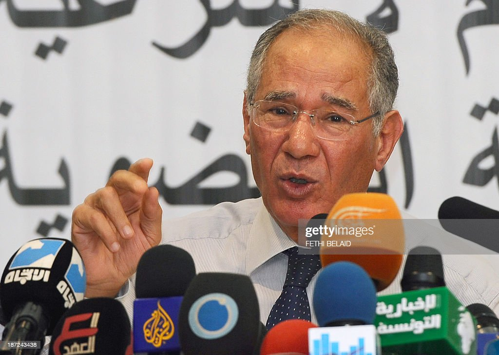 Tunisian lawyer and member of the 'Initiative for the Search for Truth about the Assassination of Chokri Belaid and Mohamed Brahmi' (IRVA), Mokhtar Trifi (R) speaks during a press conference on November 7, 2013 in Tunis to present new documents related to the assassination of the two opposition politicians. IRVA accused the Tunisian Ministry of Interior of 'hidding' ballistic test results conducted in the Netherlands, which would show that Belaid was assassinated on February 6, 2013 with a gun 'belonging to the Interior Ministry'.