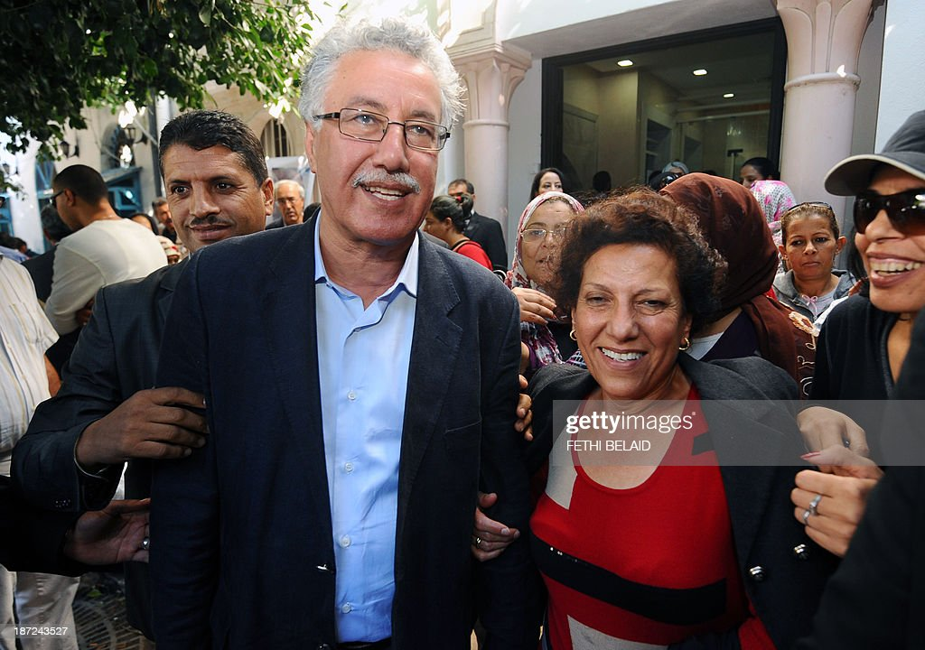 Tunisian lawyer and member of the 'Initiative for the Search for Truth on the Assassination of Chokri Belaïd' (IRVA), Radhia Nasraoui and her husband Tunisian Workers' party president Hamma Hammami (L) arrive for a press conference of the IRVA on November 7, 2013 in Tunis to present new documents related to the assassination of the two opposition politicians. IRVA accused the Tunisian Ministry of Interior of 'hidding' ballistic test results conducted in the Netherlands, which would show that Belaid was assassinated on February 6, 2013 with a gun 'belonging to the Interior Ministry'.