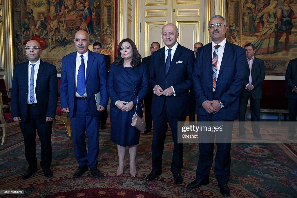 Tunisian lawyer Fadhel Mahfoudh, Abdessatar Ben Moussa, Head of Tunisan Human Rights League (LTDH), Wided Bouchamaoui, Tunisian Confederation of Industry, Trade and Handicrafts (UTICA), French Foreign Minister <a gi-track='captionPersonalityLinkClicked' href=/galleries/search?phrase=Laurent+Fabius&family=editorial&specificpeople=540660 ng-click='$event.stopPropagation()'>Laurent Fabius</a> and Samir Cheffi, Deputy Secretary of the Tunisian General Labour Union (UGTT), pose for a photo at the Quai d'Orsay on October 15, 2015 in Paris, France. Tunisia's National Dialogue Quartet won the Nobel Peace Prize for helping build democracy in the birthplace of the Arab Spring.
