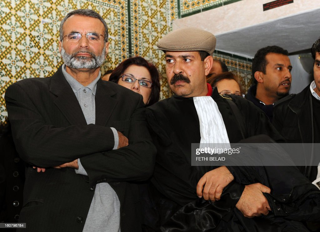 Tunisian lawyers Abderrahman Ayedi (L) and Chokri Belaid (R) look on as they attend a meeting in Tunis on December 29, 2010 to express their solidarity with the residents of Sidi Bouzid following days of rioting in Tunisia by mostly jobless and frustrated young people protesting violently against the government. Abderrahman Ayedi and Shoukri Bel-Eid was arrested the day before during unrest that has gripped the central Sidi Bouzid region since the attempted suicide on December 17 of a 26-year-old university graduate, who was forced to sell fruit and vegetables on the streets to make ends meet. AFP PHOTO FETHI BELAID