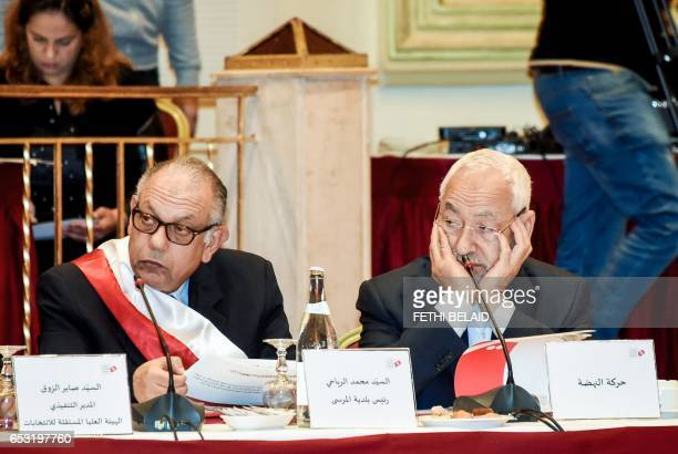 Tunisian leader of Islamist Ennahdha party Rached Ghannouchi sits next to the Mayor of La Marsa city Mohamed Riahi during a meeting in Gammarth near...