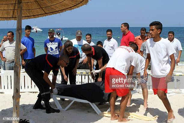 Tunisian lifeguards and medics transport a covered body in the resort town of Sousse a popular tourist destination 140 kilometres south of the...