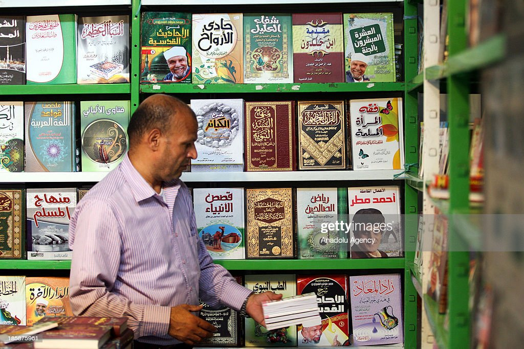 A Tunisian man takes a look at the books at the 30th edition of the Tunis International Book Fair that opens on October 25, 2013 in Tunis, Tunisia. 10 day event will host a thousand publishers from 31 countries.
