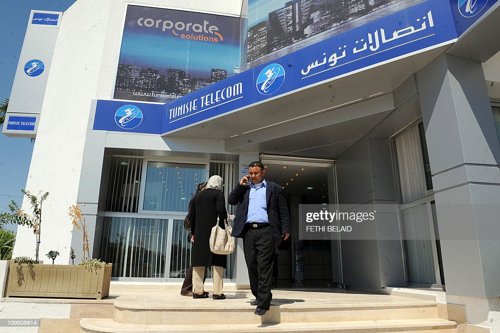 A Tunisian man talks on a rented mobile phone in front of mobile operator Tunisie Telecoms, on May 25, 2010 in Tunis.