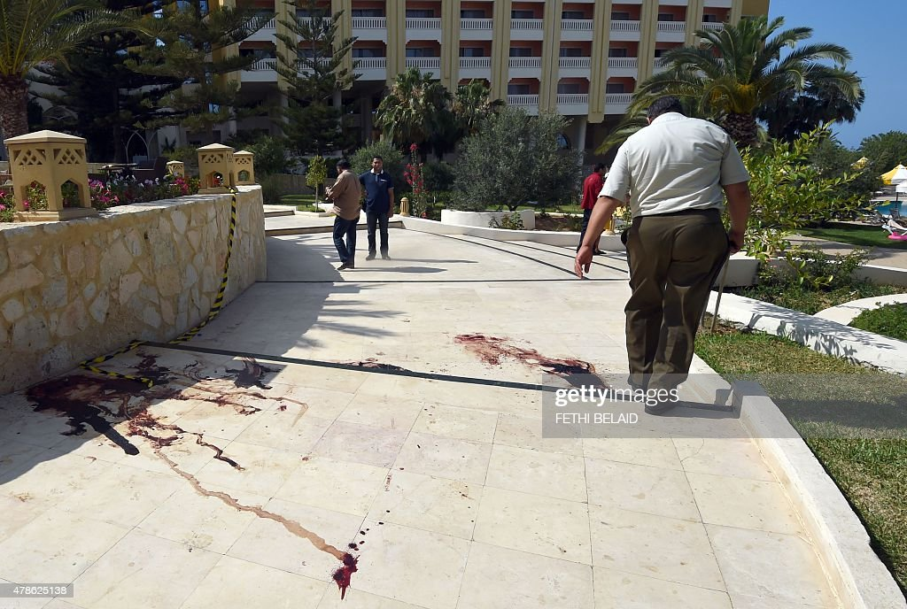 A Tunisian man walks past a blood stain on the ground at the resort town of Sousse a popular tourist destination 140 kilometres south of the Tunisian...
