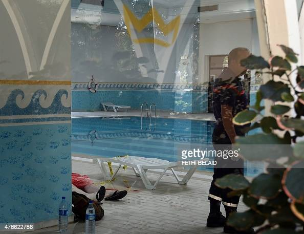 A Tunisian medic stands next to the body of a tourist at the Imperial hotel in the resort town of Sousse a popular tourist destination 140 kilometres...