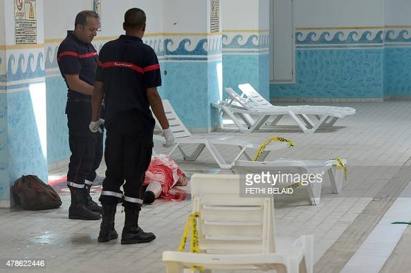 Tunisian medics stand next to a body of tourist in the pool room of a resort in the town of Sousse a popular tourist destination 140 kilometres south...