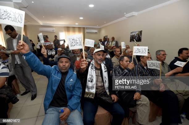 Tunisian members of the radical Islamist party Hizb utTahrir attend a speech at the party headquarters on April 15 in the Tunis suburb of Ariana /...