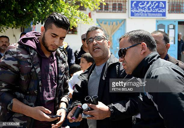 Tunisian men hold empty tear gas canisters fired by security forces to disperse social protests related to Tunisia's natural gas facility of UK based...