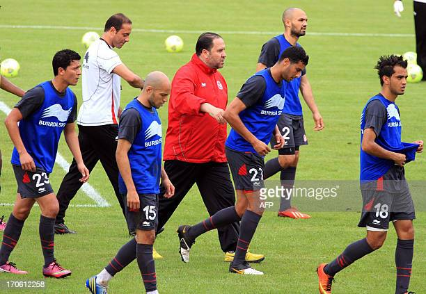 Tunisian national football's team coach Nabil Maaloul speaks with his players during a training session at the stadium in Malabo on June 15 on the...