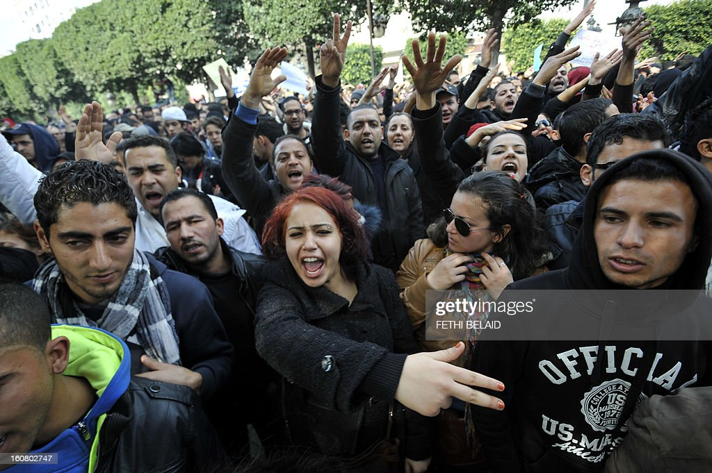 Tunisian people shout slogans during a rallye in front of Interior ministry to protest after Tunisian opposition leader and outspoken government critic Chokri Belaid was shot dead with three bullets fired from close range, on February 6, 2013. President Moncef Marzouki denounced the killing of Belaid, an outspoken critic of his government, as an 'odious assassination', while Ennahda chief Rached Ghannouchi told AFP the killers wanted a 'bloodbath' in Tunisia.