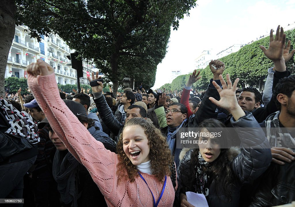 Tunisian people shout slogans during a rallye in front of Interior ministry to protest after Tunisian opposition leader and outspoken government critic Chokri Belaid was shot dead with three bullets fired from close range, on February 6, 2013 in Tunis. President Moncef Marzouki denounced the killing of Belaid, an outspoken critic of his government, as an 'odious assassination', while Ennahda chief Rached Ghannouchi told AFP the killers wanted a 'bloodbath' in Tunisia.