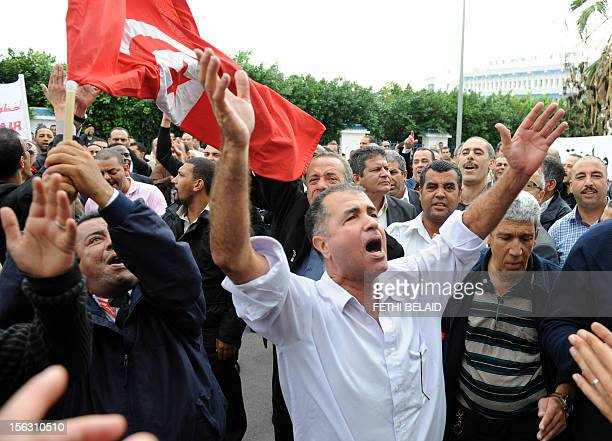 Tunisian pilots flight attendants and aircraft technicians working for Tunis Air protest in front of the Ministry of Transport' headquarters in Tunis...