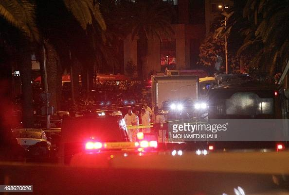 Tunisian police and forensics gather at the site of a bomb blast on a bus transporting Tunisia's presidential guard in central Tunis on November 24...