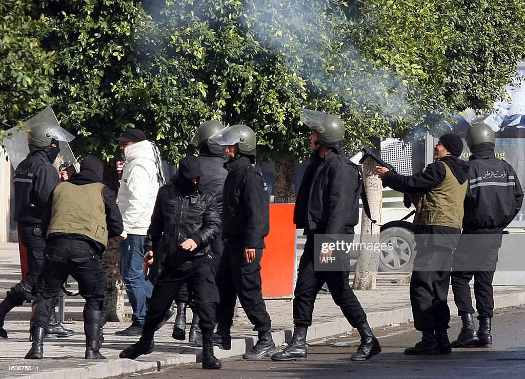 Tunisian police fire tear gas to disperse demonstrators during a rally outside the Interior Ministry in Tunis, on February 7, 2013 against the killing of opposition figure and human rights lawyer Chokri Belaid. Police was deployed in force in the Tunisian capital amid fears the murder of the 48-year-old opposition figure could reignite nationwide violence, as the ruling Islamists broke ranks over how to defuse the crisis.