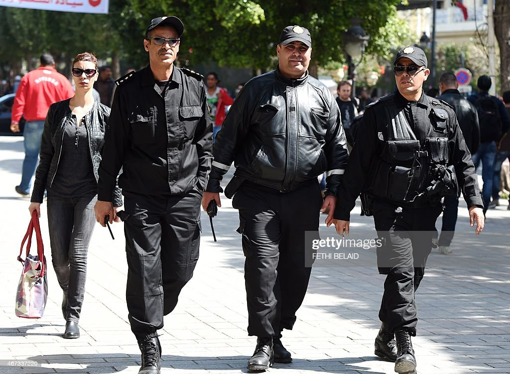 Tunisian police patrol <a gi-track='captionPersonalityLinkClicked' href=/galleries/search?phrase=Habib+Bourguiba&family=editorial&specificpeople=213571 ng-click='$event.stopPropagation()'>Habib Bourguiba</a> avenue in downtown Tunis on March 23, 2015 as the capital hosts the World Social Forum (WSF). AFP PHOTO / FETHI BELAID