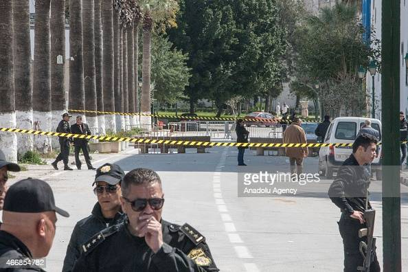 Tunisian police stand near the crime scene outside the National Bardo Museum in Tunis on March 19 2015 after the attack at museum At least 23 people...