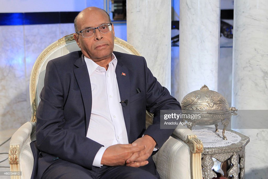 Tunisian President and presidential candidate, Moncef Marzouki speaks to the media on his being ready to collaboration with presidential candidate El-Baci Kaid es-Sibsi in case of winning the presidential election on December 08, 2014 in Tunis, Tunisia.