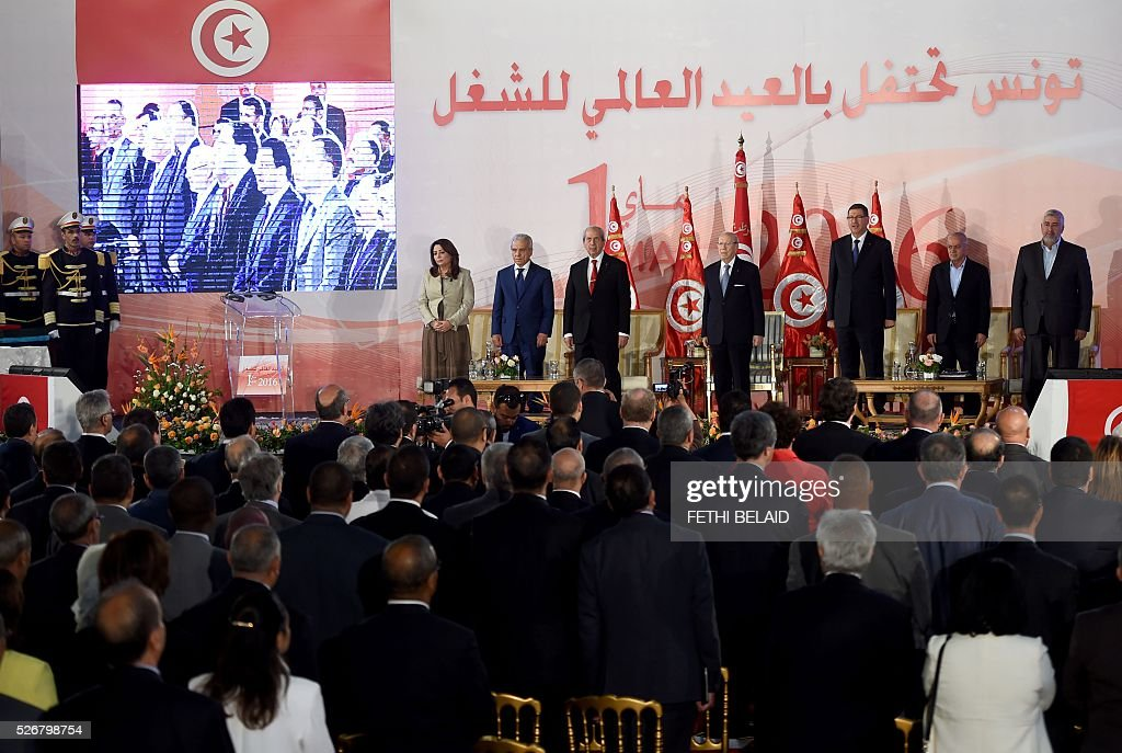 Tunisian President Beji Caid Essebsi (C) and prime minister Habib Essid (3-R) attend a May Day celebration on May 1, 2016 in the capital Tunis. / AFP / FETHI